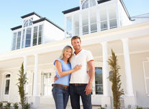 Young Couple Standing Outside Dream Home Royalty Free Stock Images