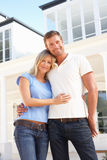 Young Couple Standing Outside Dream Home Stock Photography