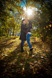 Young couple standing in park Stock Images