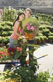 Young couple standing at pushcart Royalty Free Stock Images
