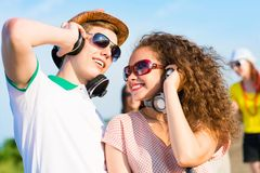 Young couple. Standing on the road, having fun with friends Stock Image