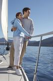 Young couple standing on sailboat Royalty Free Stock Image