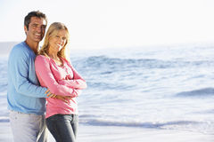 Young Couple Standing on Sandy Beach Royalty Free Stock Image