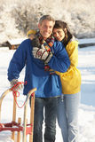 Young Couple Standing In Snowy Landscape Royalty Free Stock Photography