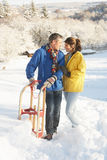 Young Couple Standing In Snowy Landscape Stock Photo