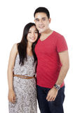 Young couple standing in studio Stock Photo
