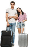 Young couple standing with suitcases Stock Images