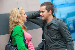 Young couple standing and talking. In a city Royalty Free Stock Photos