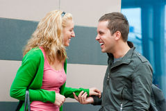 Young couple standing and talking royalty free stock photos