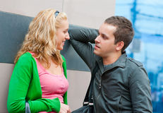 Young couple standing and talking. In a city Royalty Free Stock Photo