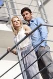 Young couple standing together at hotel balcony Royalty Free Stock Photography