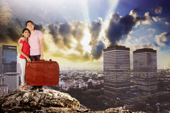 Young couple standing in the top of the rock smiling Stock Images