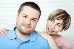 Young couple standing on white background Royalty Free Stock Images