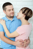 Young couple standing on white background Stock Photography