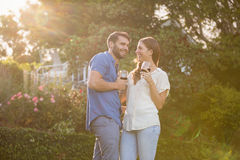 Young couple standing with wineglass. At park royalty free stock image