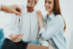 Young Couple Stare On The Key In Rieltors Hands. Bright Office. Keys In A Hand. Buying A Property. Panoramic Windows. Business Meeting. Customer And Buyer stock photography