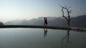 Mexico Hierve el Agua;. Young couple stay near the mineral lake, enjoy beautiful view , and happy, Mexico Hierve el Agua stock video
