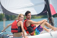 Young couple steering catamaran Royalty Free Stock Photo