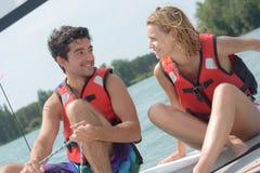 Young couple steering catamaran Stock Image
