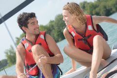 Young couple steering catamaran Royalty Free Stock Images