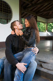 Young couple on the steps Royalty Free Stock Photography