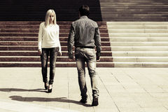 Young fashion man and woman flirting on city street Royalty Free Stock Photography