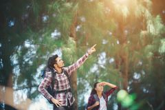 Young couple stop looking for something during hiking together. stock photos