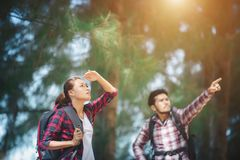 Young couple stop looking for something during hiking together. royalty free stock photos