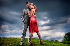 Young couple with storm cloudy sky Stock Image
