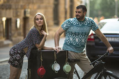 Young couple on the street with bike. Royalty Free Stock Image