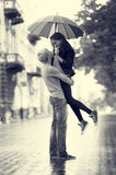 Young couple on the street of the city with umbrella. Black and white photo style royalty free stock photo