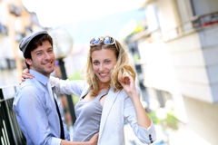 Young couple in the street having fun together Royalty Free Stock Photos