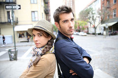 Young couple in the streets standing back to back Stock Photo