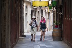 Young couple on the streets of Venice. Funny tourist couple on the streets of Venice. Popular tourist travel destination in Italy, Europe royalty free stock image