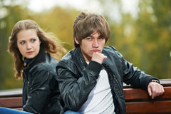 Young couple in stress relationship. Conflict and emotional stress in young people couple relationship outdoors Royalty Free Stock Photography