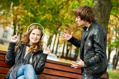 Young couple in stress relationship. Conflict and emotional stress in young people couple relationship outdoors Royalty Free Stock Photo