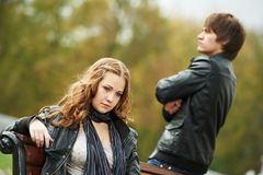 Young couple in stress relationship. Conflict and emotional stress in young people couple relationship outdoors Royalty Free Stock Images