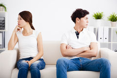 Young Couple stress and  sitting on the sofa Stock Image