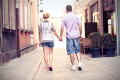 Young couple strolling about the city Royalty Free Stock Photos