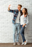 Young couple in the studio Stock Images