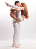 Young couple in the studio on a white background Stock Images