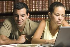 Young Couple Studying - Horizontal Royalty Free Stock Photos