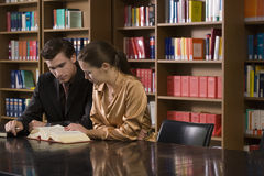 Young Couple Studying At Library Desk Stock Image