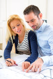 Young couple studying plans of their future house Stock Photography
