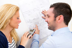 Young couple studying plans of their future house Royalty Free Stock Image