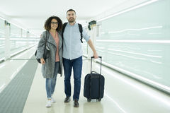 Young couple with a suitcase ready for travel Stock Image