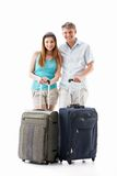 Young couple with suitcases Royalty Free Stock Photography
