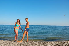 Young couple on summer beach Royalty Free Stock Images