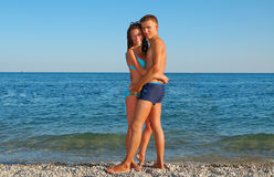 Young couple on summer beach Stock Images