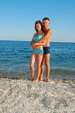 Young couple on summer beach Royalty Free Stock Photography